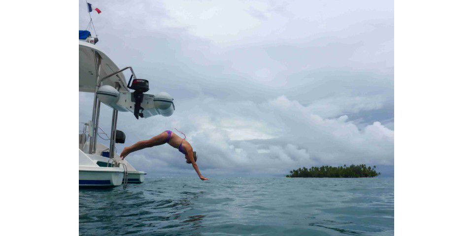 Diving from the stern of a boat in Taha'a, Tahiti, Society Islands, French Polynesia